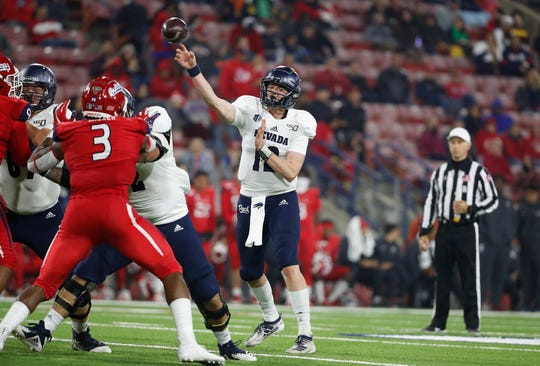 Nevada quarterback Carson Strong passes downfield against Fresno State during the second half of an NCAA college football game in Fresno, Calif., Saturday, Nov. 23, 2019.
