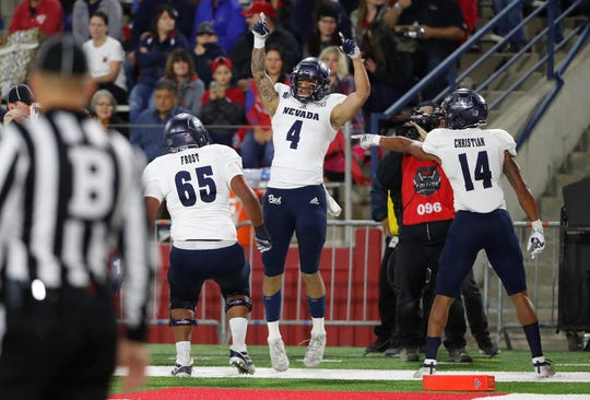 Nevada wide receiver Elijah Cooks celebrates his touchdown against Fresno State during the first half Saturday, Nov. 23, 2019.