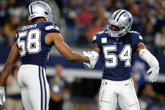 Linebacker Jaylon Smith (54) leads the Cowboys in tackles and Robert Quinn (58) leads in sacks.