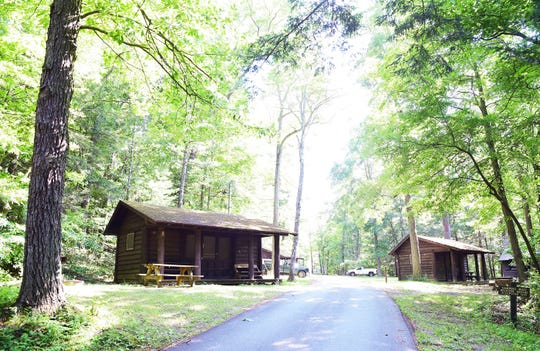 Buttermilk Falls State Park in Ithaca has 18 cabins and 25 campsites. The campground includes options for group camping and pets, with amenities such as electricity, sleeping cots, picnic tables and fire rings.