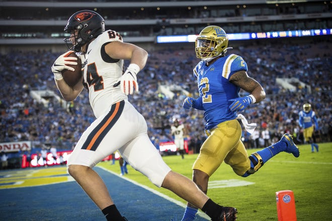 Oregon State tight end Teagan Quitoriano, a Sprague graduate, scored his first touchdown against UCLA.