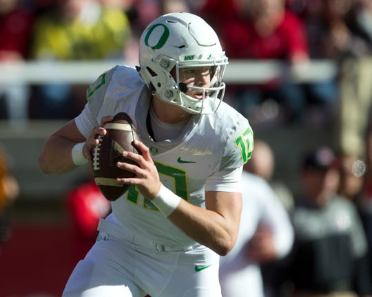 Nov 19, 2016; Salt Lake City, UT, USA; Oregon Ducks quarterback Justin Herbert (10) rolls out during the first quarter against the Utah Utes at Rice-Eccles Stadium. Mandatory Credit: Russ Isabella-USA TODAY Sports