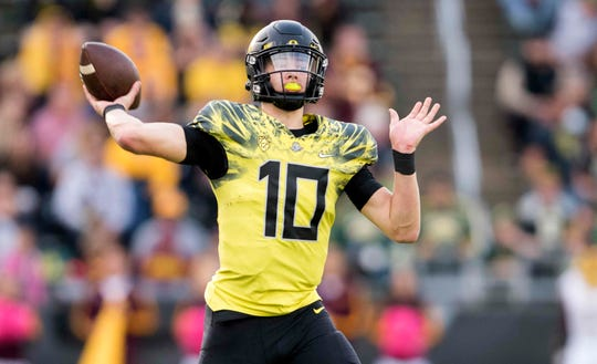 Oct 29, 2016; Eugene, OR, USA; Oregon Ducks quarterback Justin Herbert (10) throws during the third quarter against the Arizona State Sun Devils at Autzen Stadium. Mandatory Credit: Cole Elsasser-USA TODAY Sports