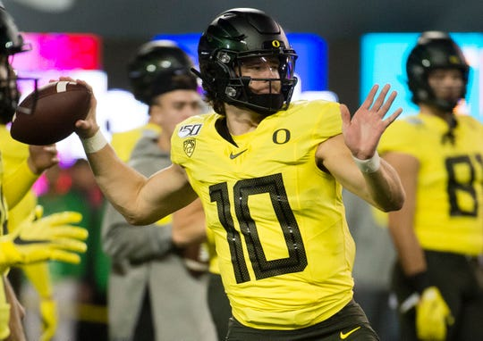 Nov 16, 2019; Eugene, OR, USA; Oregon Ducks quarterback Justin Herbert (10) throws a pass before a game against the Arizona Wildcats at Autzen Stadium. Mandatory Credit: Troy Wayrynen-USA TODAY Sports