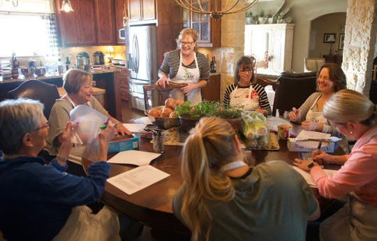 Julie Halfmann, center, teaches a cooking class from her home near Wall on Saturday, Nov. 23, 2019.