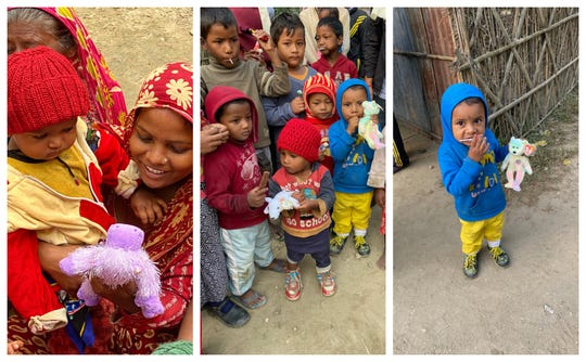 Children enjoy gifts of small plush animals and warm handmade hats presented by the Terry Mikeska Foundation at a village in east Nepal.