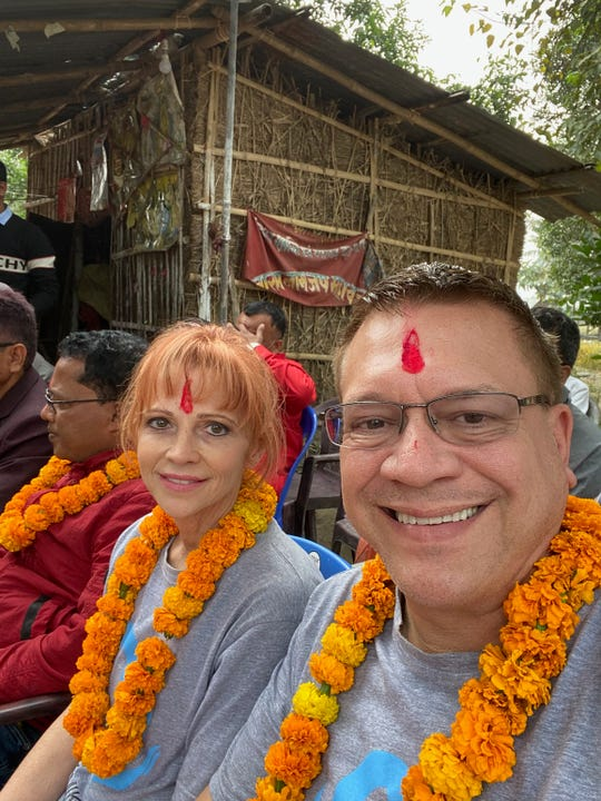 Terry Mikeska, right, and his sister, Rebekah Ocker, attend a gathering in their honor while visiting an eastern Nepalese village.