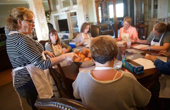 Julie Halfmann, far left, teaches a cooking class from her home near Wall on Saturday, Nov. 23, 2019.