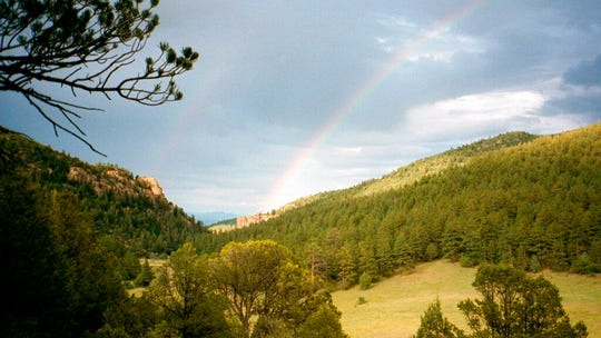 In this July 2001 file photo, a double rainbow is shown in the early evening in Philmont Scout Ranch in New Mexico. The vast ranch,  one of the most spectacular properties owned by the financially struggling Boy Scouts of America, has been mortgaged by the BSA, according to member of Philmont's oversight committee.