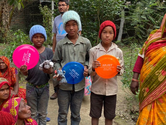 Hats and frisbees make welcome gifts for children in the villages of east Nepal.