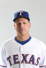 Feb. 20, 2013; Surprise, AZ, USA: Texas Rangers third base coach Dave Anderson poses for a portrait during photo day at Surprise Stadium. Mandatory Credit: Mark J. Rebilas-USA TODAY Sports