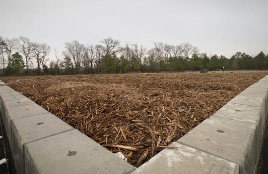 Wood chips are added to nutrients from Perdue's wastewater streams and egg shells and other waste from Perdue's hatchery to produce compost in this 2017 photo.