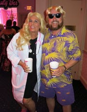 Barbie is a doctor and Ken, a beach bum                                as portrayed by Carolyn and attorney hubby  Marshall Pearce.