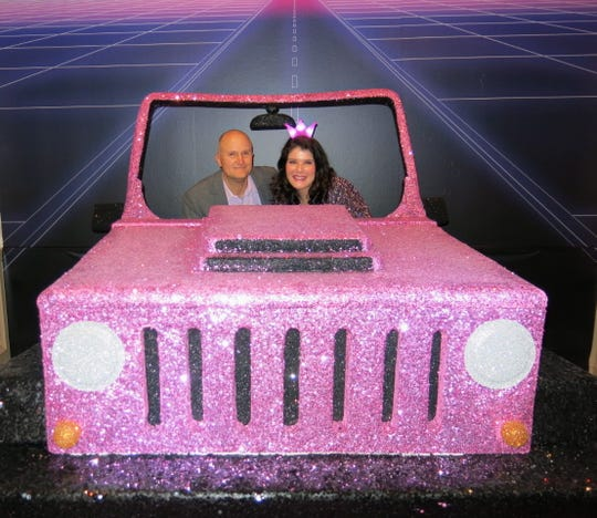 "Attorney Jerrod Thrash  and wife Dr. Sarah E. Glorioso take a ride in a jeep constructed especially  for ""Waynette's Birthday Bash."""