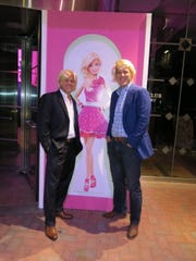 "Two ""Kens"" pose  with Barbie at the front entrance to the Petroleum Club building     where ""Waynette's Birthday Bash"" was held"