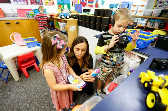 Emily McClew, a student clinician at Missouri State's preschool for deaf and hard of hearing children, works with students during class on October 1, 2019.