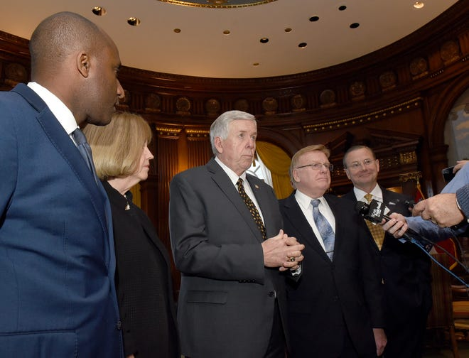 Governor Mike Parson, center, takes questions from the media with, from left, Kansas City Mayor Quinton Lucas, St. Louis Mayor Lyda Krewson, Parson, Springfield Mayor Ken McClure and Columbia Mayor Brian Treece Monday at the Governor's office in the Capitol building.