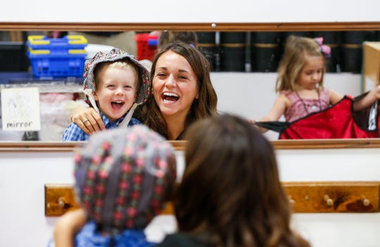 Emily McClew, a student clinician at Missouri State's preschool for deaf and hard of hearing children, smiles and laughs with a student during class on October 1, 2019.