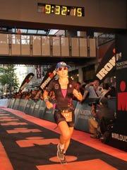 Caitlin Alexander, a former runner at Robert E. Lee High School, finishes the Ironman Louisville in October.