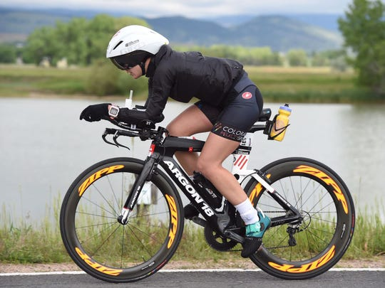 Caitlin Alexander, a former Staunton resident, races her bike during a portion of Ironman Boulder this year.