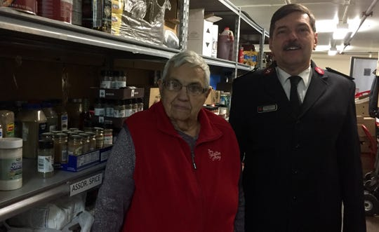 Part-time Salvation Army worker and volunteer Kathy Finlayson and Major Mike Parker stand in the Salvation Army food pantry Monday, Nov. 25, 2019 in St. Cloud.