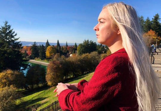 In this Oct. 28, 2019, photo, Ashtyn Aure poses for a photo in Portland, Ore. When Aure visited a clinic at Utah Valley University last year, she felt like she was having a breakdown. When she asked to see a counselor, a staff member told her the wait list stretched for months. She left without getting help. (AP Photo/Gillian Flaccus)