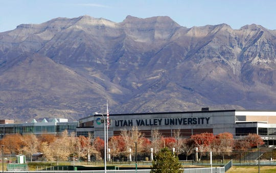 This Nov. 14, 2019, photo shows the campus of Utah Valley University in Orem, Utah. More college students are turning to their schools for help with anxiety, depression and other mental health problems. At Utah Valley University there is one counselor for every 4,000 students.  (AP Photo/Rick Bowmer)