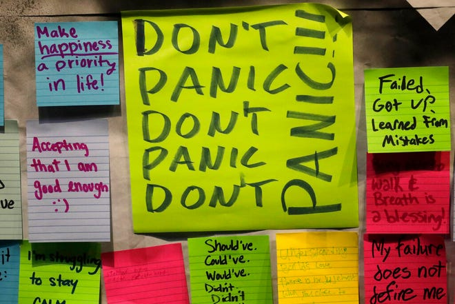 This Nov. 14, 2019, photo shows notes attached to the Resilience Project board on the campus of Utah Valley University in Orem, Utah. The purpose of the project is to let students know that it is OK to struggle. More college students are turning to their schools for help with anxiety, depression and other mental health problems. That's according to an Associated Press review of more than three dozen public universities. (AP Photo/Rick Bowmer)