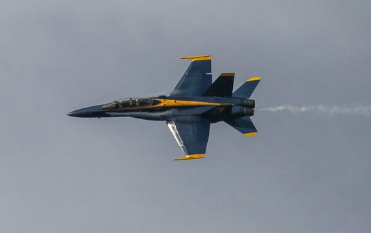 A Blue Angels F/A-18 Hornet, with the crew of Navy Lt. Julius Bratton and Navy Lt. Cmdr. Adam Kerrick, makes a sharp banking turn to the east before landing at the Vero Beach Regional Airport on Monday, Nov. 25, 2019, to meet with local officials for their appearance in the Vero Beach Air Show in April 2020.