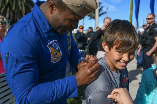 "Jude Stefan (right), 10, of Vero Beach, gets his shirt autographed by Blue Angel pilot U.S. Navy Lt. Julius Bratton after the Blue Angels team of Bratton and Lt. Cmdr. Adam Kerrick landed their F/A-18 Hornet aircraft at the Vero Beach Regional Airport on Monday, Nov. 25, 2019, to meet with local officials and help promote the Vero Beach Air Show, coming in April. ""It's amazing that I can see the Blue Angels, and how cool they are,"" Stefan said after getting both of their autographs."