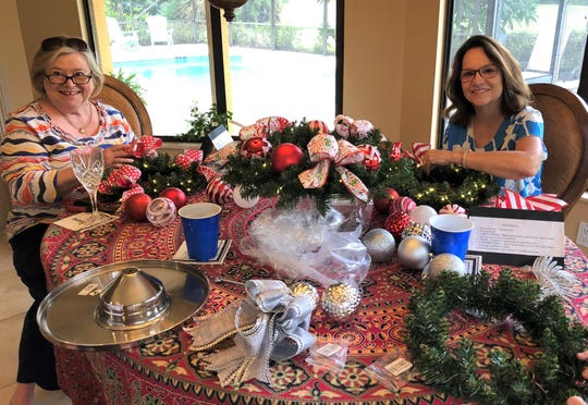 Creggie Henderson, left, and Sharon Nealy make wreath centerpieces for the tables at the Dec. 9 Christmas Cookie Luncheon benefiting Caring Children Clothing Children. The event is at Mariner Sands Country Club in Stuart.