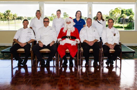Chefs competing in the Dec. 9 Christmas Cookie Luncheon are, seated, from left, Charles Rosselli, Sailfish Point Country Club; Eric Potsinger, Mariner Sands Country Club; Santa (who plans to eat the cookies); Chris Brooks, Willoughby Golf Club; and John Saundry, Mariner Sands; standing, Colette Stallone and Jessica Baier, Sailfish Point; Sabrina LeClair, Panera Bread district manager; and Laurie Frost of Love and Hope in Action.