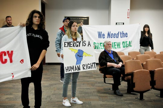 Several El Pasoans protest the proposed sale of El Paso Electric during a City Council special meeting Monday, Nov. 25, 2019.