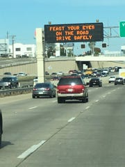 "A Texas Department of Transportation sign from 2018 reminds people to ""Feast your eyes on the road"" as they drive."