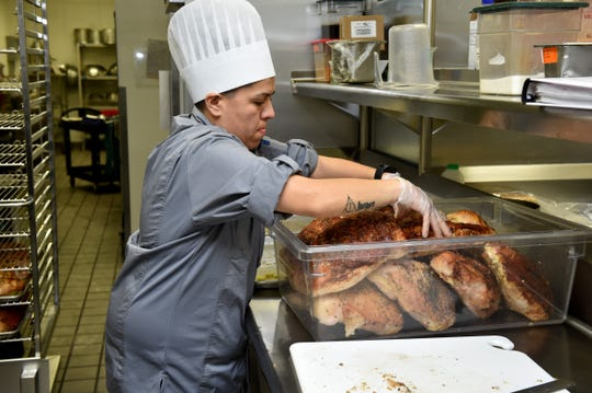 Nancy Salazar, sous chef at Community Memorial Hospital, organizes turkey for the hospital's annual Thanksgiving dinner.