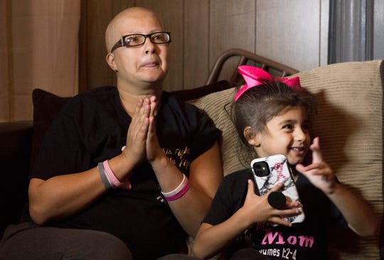 Luz Rivera, who is battling cancer, sits with her 5-year-old daughter Izalyn in their Vineland home.   The family was selected for the Salvation Army Adopt-A-Family showcase, which will kickstart a campaign to help link 200 families in need with benefactors.