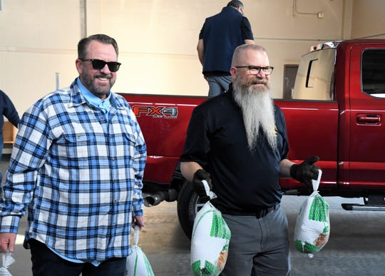 Members of the Visalia Breakfast Lions deliver turkeys to the California National Guard Daniel Unger Memorial Armory on Monday, Nov. 25. This year, the club is donating more than 1,000 turkeys to charities and organizations around town. This is their 25th year doing a turkey drive.