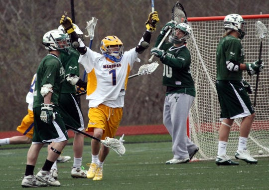 Mahopac's Jon Bota (1) celebrates a first half goal against Yorktown during boys lacrosse game at Mahopac High School April 16, 2011. Mahopac won the game 12-11 in double overtime.