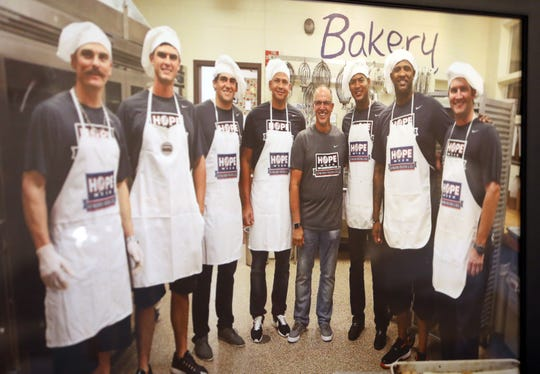 A photo of founder Frank Squeo and players from the New York Yankees who volunteered with Baking Memories 4 Kids hangs at the packing center Nov. 25, 2019, in Valley Cottage. The foundation gives children with life threatening and /or terminal illnesses and their families an all-expense paid vacation to Disney World from the profits of selling cookies.