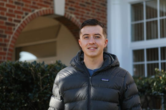 Student veteran Cameron Newberry poses in front of the library at Wilmington University on Monday, Nov. 25, 2019.