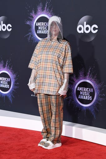 """The American Music Awards, hailed as """"the world's largest fan-voted awards show,"""" were Sunday at the Microsoft Theater in LA. Billie Eilish made waves in head-to-toe Burberry, including a sparkly veiled hat. Read on to see what other stars wore on the red carpet."""