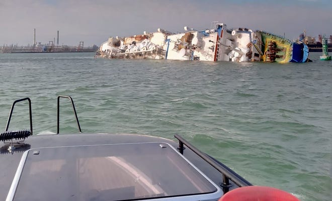 """This handout photo made available by the General Inspectorate for Emergency Situations (IGSU) shows a capsized livestock transpot vessel, in the """"Midia"""" Black See harbour near Constanta on November 24, 2019."""