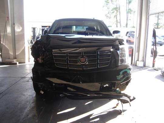 A view of the 2009 Escalade Tiger Woods drove when he collided with a row of hedges and a fire hydrant outside his Florida home on Nov. 27, 2009.