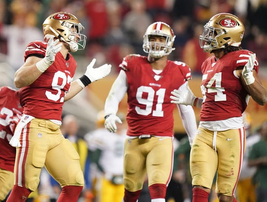 49ers defensive end Nick Bosa, left, celebrates a sack against Green Bay.