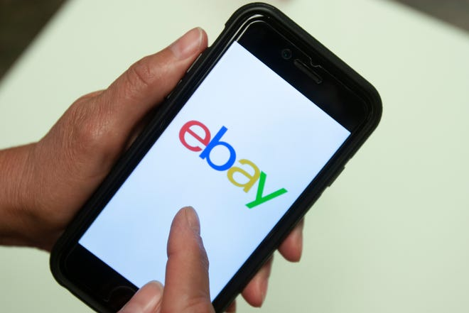 In this July 11, 2019, file photo, an Ebay app is shown on a mobile phone in Miami. EBay is selling StubHub to ticket seller viagogo for $4.5 billion.