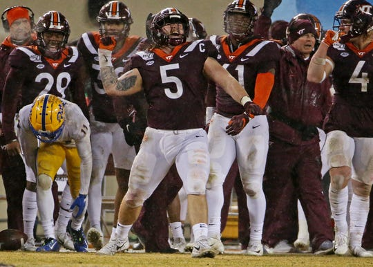 Virginia Tech defensive lineman Jarrod Hewitt celebrates after a play during the fourth quarter against Pittsburgh.