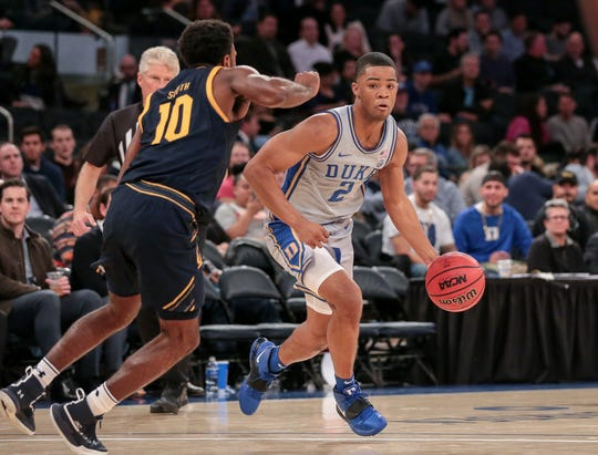 Duke guard Cassius Stanley drives against California guard Kareem South during the second half at Madison Square Garden.