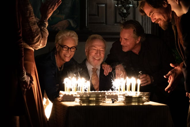 "Wealthy mystery writer Harlan Thrombey (Christopher Plummer, center) celebrates his birthday with family members (Jamie Lee Curtis, Don Johnson and Michael Shannon) before turning up dead in ""Knives Out."""