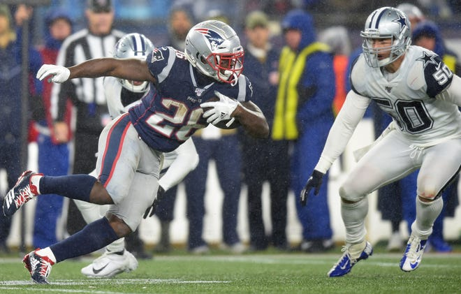 Sony Michel runs with the ball against the Cowboys.
