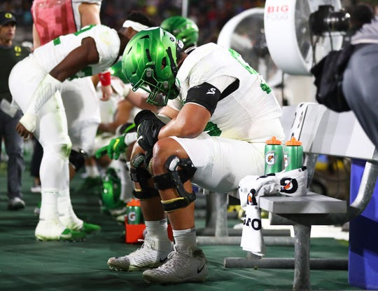 Oregon offensive lineman Penei Sewell reacts on the bench in the closing minute of the game against Arizona State at Sun Devil Stadium.